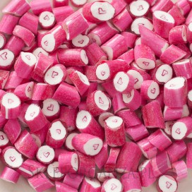Różowy Cukierki karmelki ciemnoróżowe z sercem
