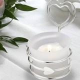 Szklane dekoracje i świece na stół weselny